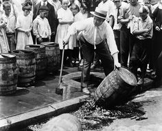 Children watch as a prohibitionist destroys a barrel of beer with an ax during the 1920s.This Is What America Looked Like When Alcohol Was Illegal