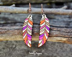 Wood native earrings - feather  laser cut & hand painted (purple - pink - orange)  Length of earrings 6 cm    If you have any questions or