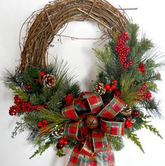 The Country style Christmas Wreath is simple and Beautiful! It would be perfect for a cabin or house in the woods!    Its a grapevine base decorated in a C shape with different Christmas greens, berries and pine cones. The bow is made with a red, green and gold plaid wired ribbon with a antique looking bell.    Width 18 inches by 20 High by 8 inches deep    All my wreaths make great gifts! If you wish to purchase this wreath as a gift, I will be happy to include a hand-written card to the…