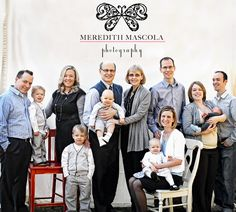 large family portrait-- use of different color chairs at different heights