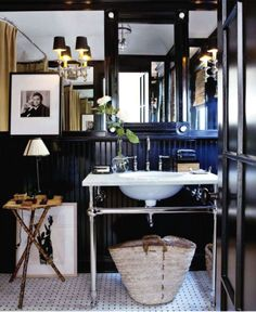 Glossy black walls and basketweave tile  with a washstand  Lose the table and its perfection