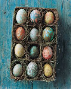 Easter Crafts: Nestle each of your marbleized eggs in its own bed of grass. Using cardboard dividers, create 12 compartments in a shallow box or an empty shirt carton, then fashion a snug nest of dried grass inside each square. Save the lid for storage.