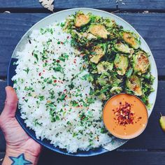 """vegannomadchick: """" Loads of rice and roasted brussels sprouts for dinner!  The shredded brussels are from Trader Joe's. I seasoned them with chili powder, cumin and black pepper and roasted them on..."""