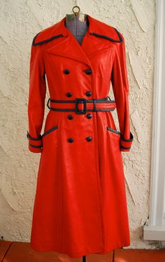 Vintage 1960s AMAZING Red Leather Military Trench Coat. $325.00, via Etsy.