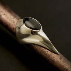 White bronze and black onyx ring based off the plague doctors mask used most famously during the black death.