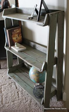 This would work great for my office ~ think I need to get my husband started on it ~ might get it by next year. Pallet Bookshelf - might have to find me TWO pallets and make a bookshelf to match the headboard!!