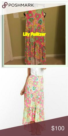 Lilly Pulitzer  Canyon Tiered Skirt This is gorgeous but I live in fl and it's too hot to wear something long like this even  for the winter it doesn't get cold enough.  Canyon tiered skirt falls beautifully and the bonus is you can actually wear this as a dress. Gorgeous lily flower pattern with her beautiful colors. Retails $186. Pic 2 is just showing it modeled. Actual color is more of pic 1. Materials include rayon and spandex.   Bundles welcome great discounts  No rude comments or you…