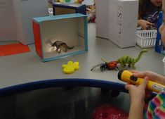 Math Center- provide shoebox, small objects, flash light, and measuring tool such as snap cubes. Students create a shadow and then measure it. Preschool Groundhog, Dinosaurs Preschool, Preschool Lesson Plans, Preschool Themes, Kindergarten Science, Preschool Activities, Shadow Theme, Light And Shadow, Light In The Dark