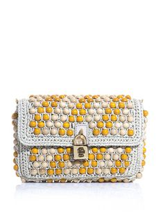 Dressed up or down, Dolce Gabbana's #beaded rafia #clutch is a must-have for summer.