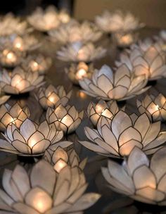 Group a bunch of Lotus tealight candle holders together for a romantic festive moment.