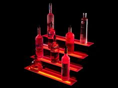 The Armana Four Tier LED Liquor Display is perfect for displaying a large number of liquor bottles or any other items you may choose to display. Bar Shelves, Display Shelves, Liquor Shelves, Bar Displays, Led Panel, Liquor Bottles, Bar Lighting, Bars For Home, Bulb