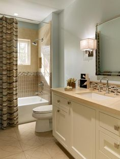 PALE BLUE BATHROOM WITH TILE ACCENTS