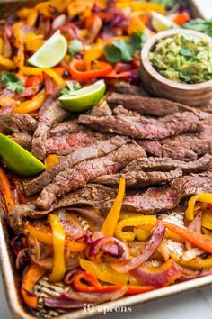 A quick and easy sheet pan fajitas recipe with super tender steak and a quick guacamole. With flank steak, peppers, and onions, this healthy Mexican recipe is a one-pan dinner. Healthy Mexican Recipes, Paleo Recipes, Paleo Food, Paleo Diet, Delicious Recipes, Ketogenic Diet, Healthy Steak, Healthy Eating, Steak Recipes