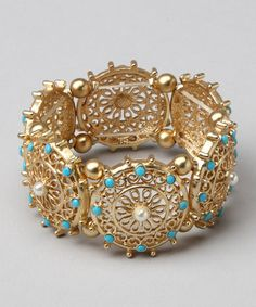 Take a look at this Gold & Turquoise Stretch Filigree Bracelet by Marlyn Schiff on #zulily today!