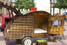 A homemade camper that sleeps 2 made to resemble Lincoln Logs.
