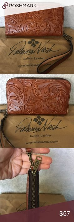 Patricia Nash Leather Zip Wallet NWOT Patricia Nash hand-tooled Italian leather zip wallet, with detachable wrist strap.     New condition, never used.   Burnished hardware.    Fits most phones (excluding iphone plus)    Includes dustbag and registration card. Patricia Nash Bags Wallets