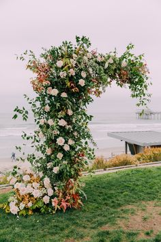 Unique wedding ceremony floral installation. Scripps Seaside Forum La Jolla @organicflora @idoweddingsandevents