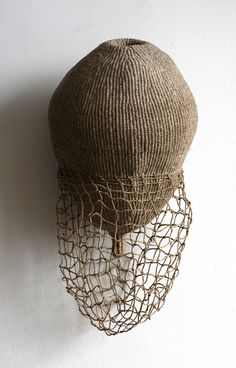 imminence, twined linen and hand knotted netting. Ann Coddington Rast