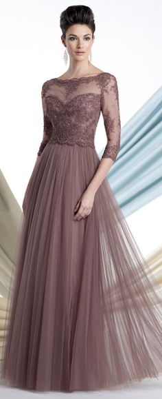 Soft illusion A-line gown with three-quarter length sleeves, scalloped lace bateau neckline, lace trimmedillusion over sweetheart lace bodice with back covered buttons, finely pleated full skirt.