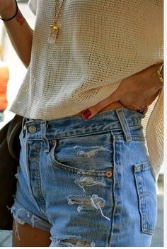 Buy high-waisted jeans from a thrift store, cut off and fray.