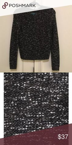 Alice + Olivia Inka Metallic Sweater Alice + Olivia  Black/White/Metallic  57% Polyester 25% Nylon 14% Acrylic 4% Mohair  Dry clean only.  Retails for $275 + tax. Excellent used condition Alice + Olivia Sweaters Crew & Scoop Necks