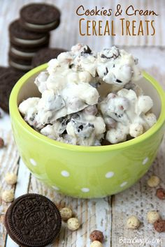 Cookies and Cream Cereal Treats - White chocolate clusters of Oreo pieces, marshmallows and cookies and cream cereal! All you need is a microwave and a couple minutes to whip up these delicious and simple treats!