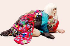 Elena Stonaker is part fine artist, part fashion designer with the sensibilities of a quilter thrown in for good measure. She makes dolls, paints pictures, and fashions bizarre wearable sculptures from amalgamations of fabric, jewels and imagery that sit somewhere between tapestry and garments. In short, she is one of a kind.