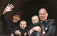 The royal couple held daughter Princess Gabriella and son Prince Jacques - who were born on December 10, 2014 - as they greeted the crowd from the palace's balcony.