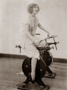 23rd March 1921:  A woman using a stationary cycle.  (Photo by Topical Press Agency/Getty Images)