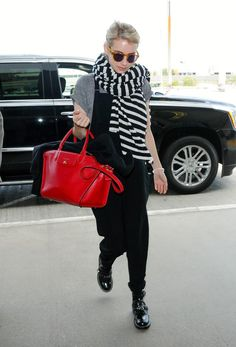 Celebrity Fashion and Style - Emma Roberts in Chic Black Overalls and Stripes