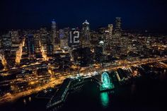"""Breathtaking photos of Seattle all dressed up for the Seahawks. """"The night before the night before"""" series. Jan 16, 2015, before the NFC Championship game Seahawks vs Packers."""