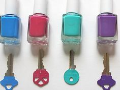 Do you have nail polishes? You can distinguish keys by using nail polish. You don't have to buy some key holders.