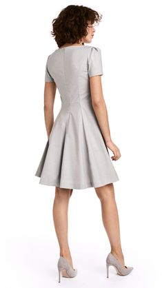Short dress in thick, woven fabric with short puff sleeves. Concealed back zip, fitted bodice, and circle skirt. Short Dresses, Dresses For Work, Dresses With Sleeves, The Dress, High Neck Dress, Lady Grey, New Wardrobe, Fitted Bodice, Rock