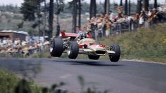 Legendary Triple Crown winner (24 Hours of Le Mans, Indianapolis 500 and Formula One) Graham Hill shown here in his Lotus 49C at the 1969 F1 Nürburgring circuit.