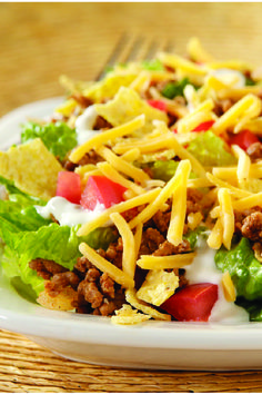 Quick Taco Salad – This Quick Taco Salad recipe is a delectable mash-up of fresh lettuce, tomatoes, cheese, and lean ground beef, without the hassle of stuffing a shell.