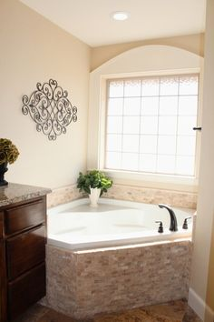 Pic On master bath corner tub Legend Homes Custom Home Builder Abilene TX