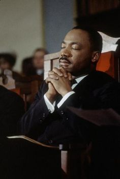 Martin Luther King, Jr leads a prayer in a church before the second Selma to Montgomery Civil Rights march, also known as 'Turnaround Tuesday', Selma, Ala., March 1965.