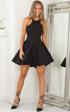 Black High Neckline Open Back Skater Dress for only $69.95. Browse the UsTrendy catalog for the latest trends in indie fashion!