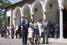 Family affair: The quartet were joined by Queen Sofia (back, second left) and King Juan Carlos.