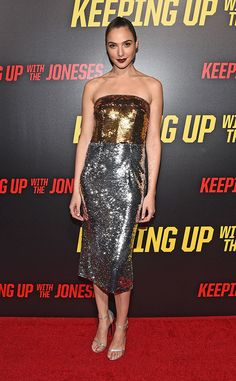 Shine On from Fashion Police  Gal Gadot shines at the Keeping Up With the JonesesL.A. premiere in a strapless and sparkly Dolce & Gabbana gown paired with Neil Lane jewelry and metallic Stuart Weitzman heels. The dress is fun and flirty in its own way, but it would have been nice to see her play it up with an accessory or two.