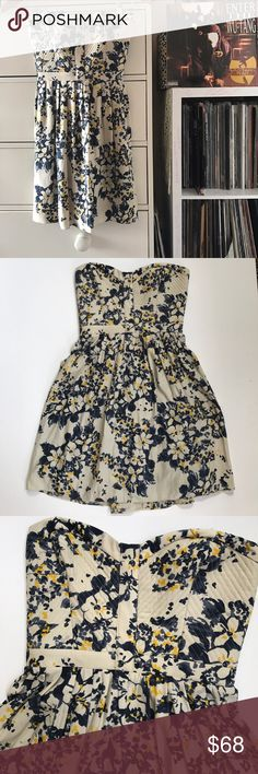 """Parker Floral Silk Dress Parker  Strapless Silk Dress  Fitted structured bodice  Flowy fully skirt Lined  Smocked back  Back zip  Gray silk  Blue and yellow floral flower watercolor print  Size small best fits 2/4 Measurements laying flat  Bust 12.75"""" Waist 12"""" Hip 18.5"""" Length 25.5""""  Very excellent preowned condition 8.8/10 Parker Dresses Strapless"""