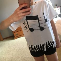 Music note fringe t-shirt! This is a custom made white t-shirt with music notes on it. The fringe on the bottom is hand made and will not fray. It is in good shape, but there is a small blue/green dot stain on the front, which is why the price is so low. Still super cute for a music lover! Tops Tees - Short Sleeve