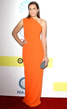 Mandy Moore in a one-shoulder orange Solace London dress