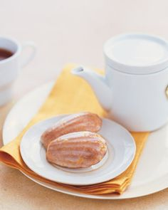 These shell-shaped, cakey cookies are a French treat traditionally served with tea. The buttery madeleines are spiced with ground cardamom and coated with a sweet citrus icing.