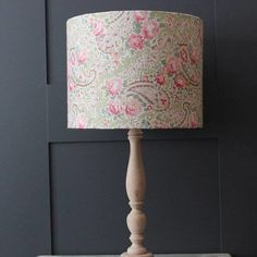 A gorgeous lampshade in a linen floral fabric.  Our hand crafted drum lampshades are suitable for table, standard and pendant light fittings.  Available in a range of sizes, they're designed to co-ordinate with our other Pins and Ribbons products and look great in either contemporary or period settings.  The fabric used for this lamp shade is also available in memo/pin boards.  Please note: All of our shades are suitable for use with a 40 watt bulb and are fire retardant.  Available as  30…