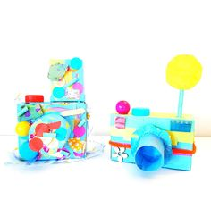 Say Cheeeeeese! - Mixed Media Cameras. Super cute and fun recycled Camera Craft for Kids! Love this! #recycled #cardboard #kidscrafts #camera #play #preschool