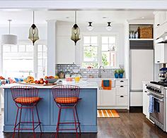 Go for something unexpected and paint the kitchen hutch, buffet or island an on-trend color.