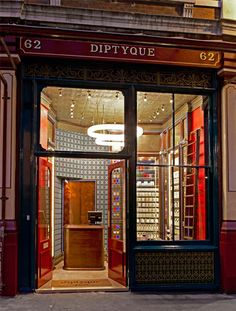 Looking like something out of a costume drama, the store has been developed in the grand style of Victorian architecture with both English and French influences. Located in London's Leadenhall Market, the space stands out from the sidewalk with its dark wooden exterior framing and very Victorian shop front.