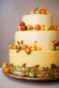 Fall fruit and foilage wedding cake (Photo by Sarah Postma Photography)