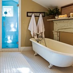 A hit of blue makes a suprising appearance in this #countrystyle #bathroom. #decor #homesplusmag
